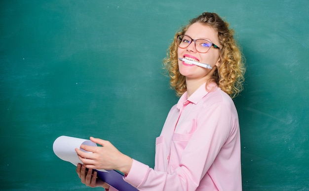 Report project. back to school. girl teacher at school lesson. happy student in glasses at blackboard. teacher with document folder. new school year. girl prepare for exams. diary for girls concept.