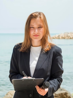 Reporter at the sea