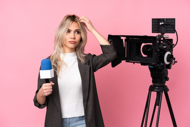 Reporter teenager woman over isolated wall