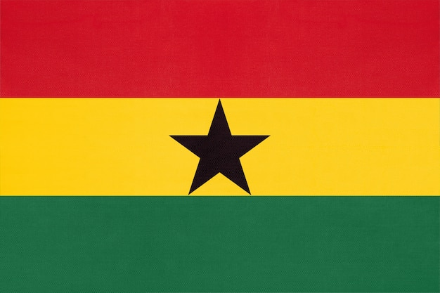 Republic of ghana national fabric flag, textile background. symbol of world african country.