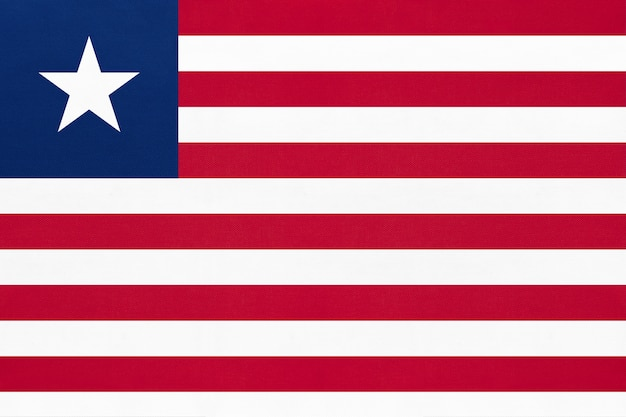 Republic liberia national fabric flag textile background. symbol of world african country.