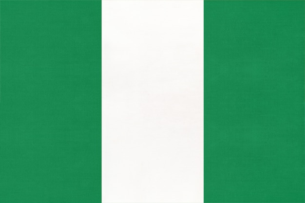 Republic of nigeria national fabric flag, textile background. symbol of world african country.