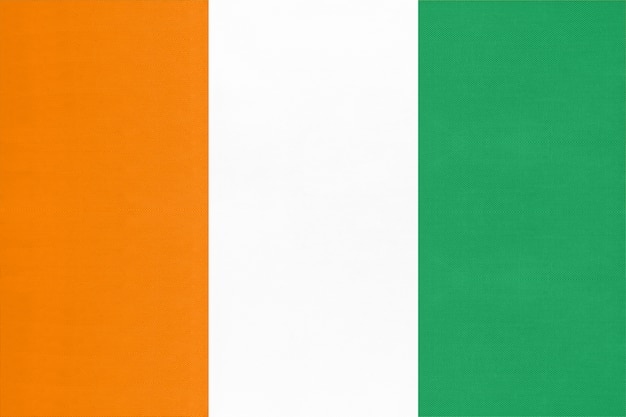 コートジボワール共和国の国旗、テキスタイル背景世界のアフリカの国のシンボル