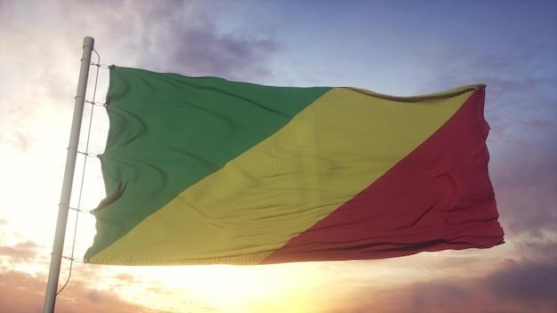 風、空、太陽の背景に手を振っているコンゴ共和国の旗。 3dレンダリング。
