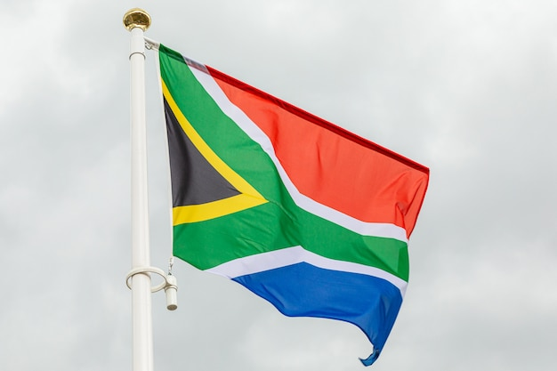 Republic of south africa flag against white cloudy sky