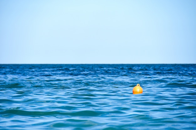 Rescue buoy floats on waves in sea water