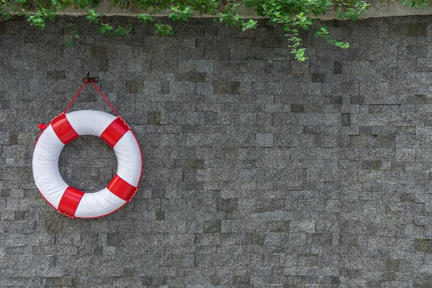Rescue buoy hanging on the wall with copy space