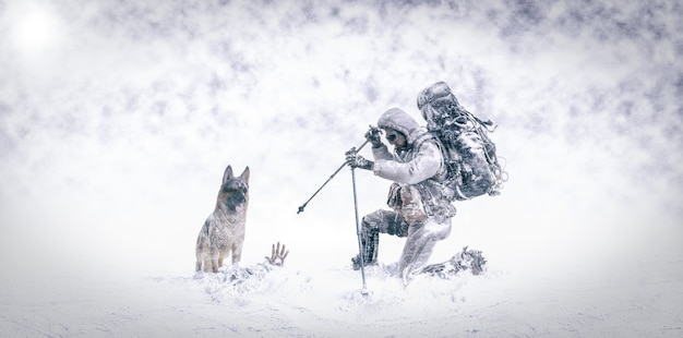 Rescue in the snow with german shepherd dog and firefighter mountaineer