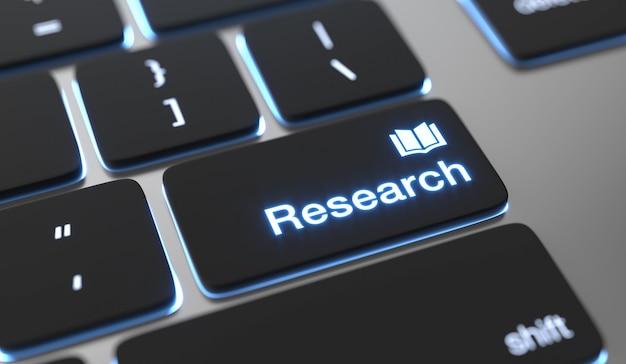 キーボードボタンに書かれた研究テキスト。