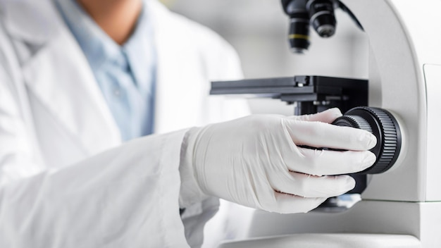 Researcher with microscope in the biotechnology laboratory
