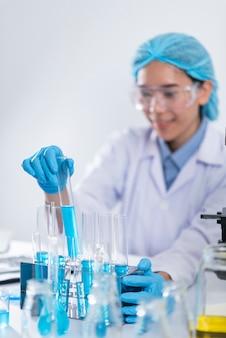 Researcher working with glassware, glass equipment in scientific genetic laboratory