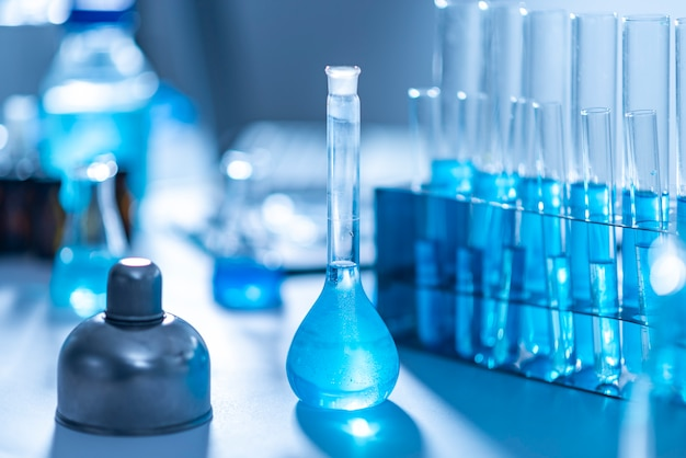 Researchers are using glassware and blue solutions in laboratories, research on cosmetics and energy.