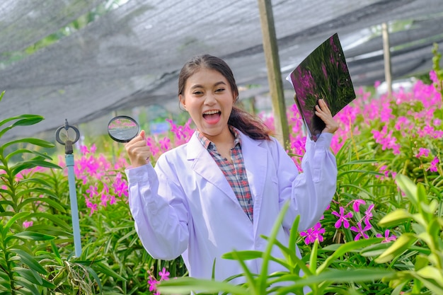 Researchers in orchids in white are delighted with the results of orchid research.