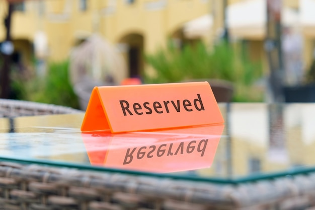 Reserved plate on the table of a street restaurant