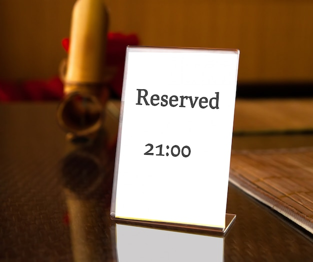 Reserved sign on table in restaurant