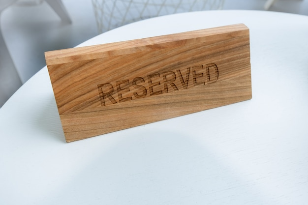 Reserved table sign restaurant cafe tag outside terrace summer text