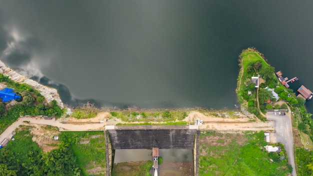 Reservoir in the valley in the rain season aerial top view from drone