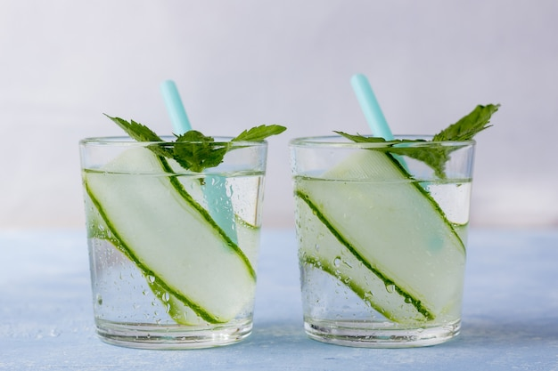 Resh cool detox drink with cucumber, lemonade in a glass with a mint