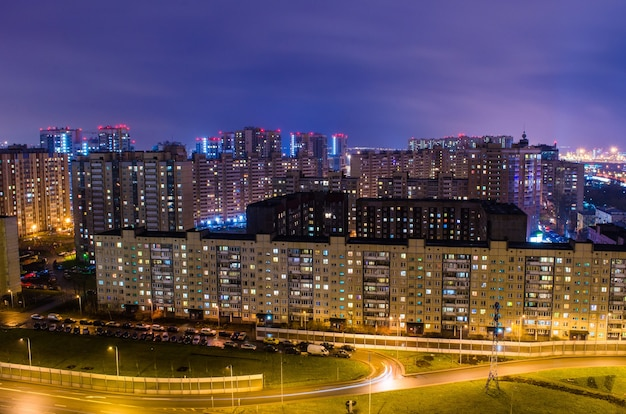Residential area with houses at night view of the city.