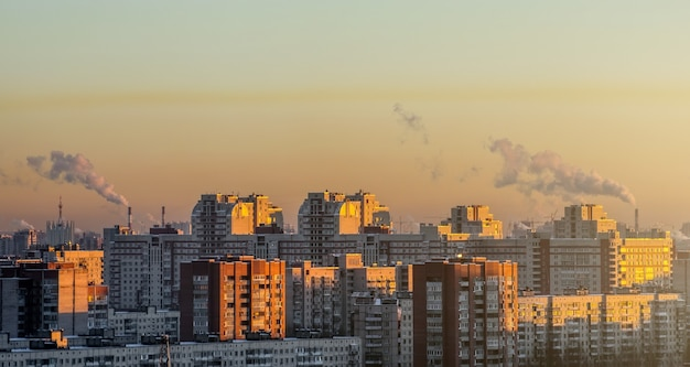 Residential arrays of high-rise buildings on the horizon sunset.