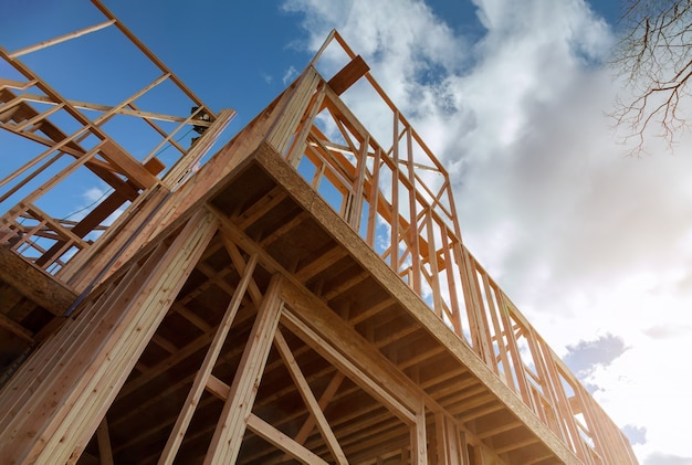 Residential construction home framing on new house wooden under construction material in wooden frame