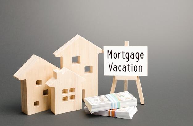 住宅と住宅ローンの休日のイーゼル。債務返済の延期または前払い。経済的な柔軟性とセキュリティ