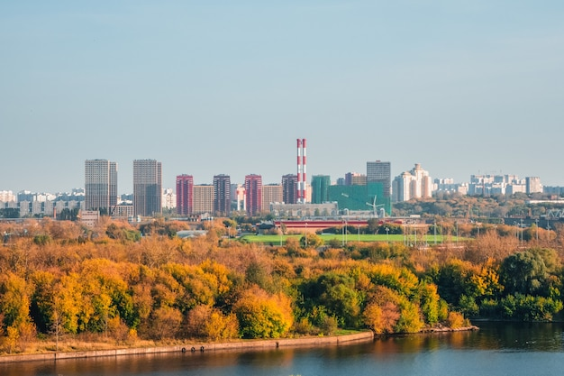 Residential neighborhood in an industrial area on the outskirts of moscow. autumn view from the hill to the city in the distance.
