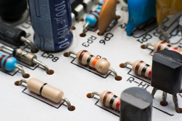 Resistor, capacitor and transistor on circuit board close up. electronic hardware