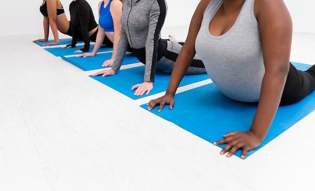 Resitance exercise at gym on mat