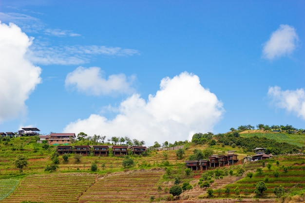 Resort on mountain with blue sky and white cloud.