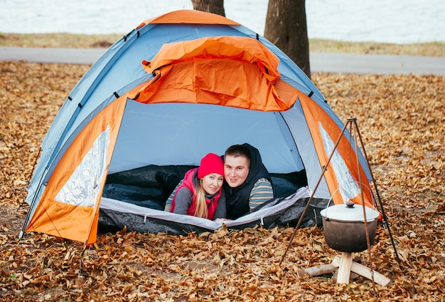 Rest on the nature of a young couple in a tent.
