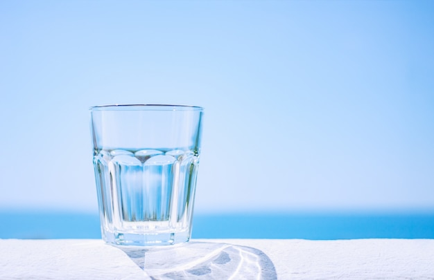 Rest on the sea. empty glass cup on the background of the sea.