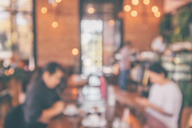 モンタージュ製品の表示の背景のための顧客のぼかし抽象的なビンテージスタイルのボケライトとレストランのカフェやコーヒーショップのインテリア