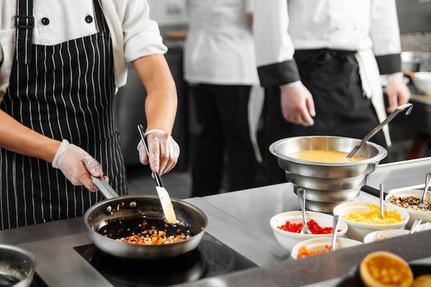 Restaurant cooks preparing food in the kitchen