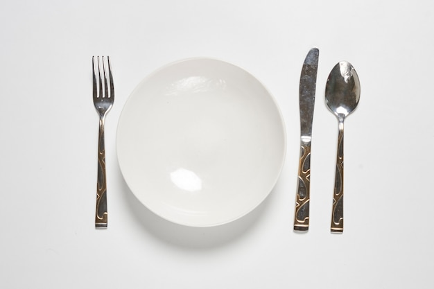 Restaurant eating items  fork spoon and knife on white background