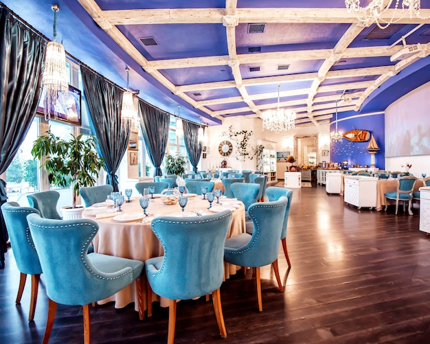 Restaurant hall with blue chairs and decors on the wall