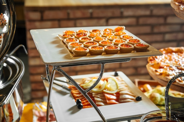 Restaurant lunch catering buffet with different appetizers