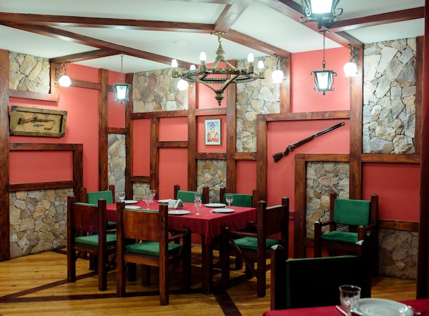 Restaurant room with guns on wall