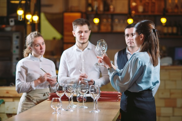 The restaurant staff learns to distinguish between glasses.