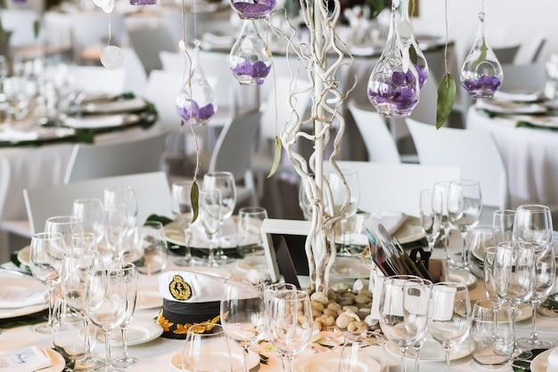 Restaurant table decorated for wedding celebration