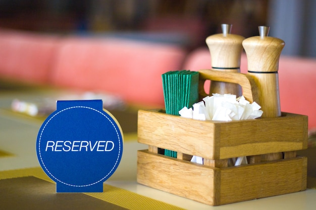 Restaurant table setting service for reception with reserved card