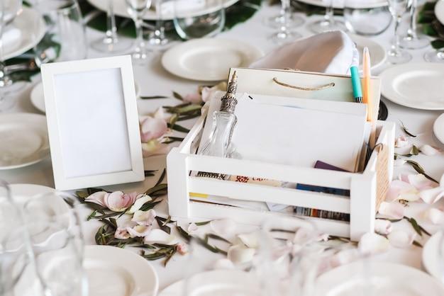 Restaurant tables decorated for wedding celebration