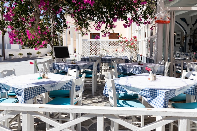 Restaurant terrace in front of the beach in kamari on the island of santorini