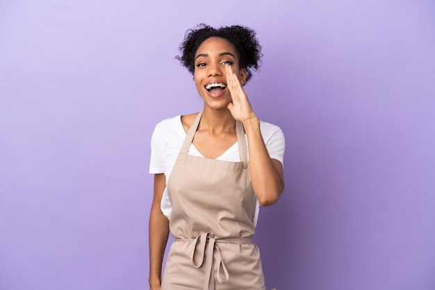 Restaurant waiter latin woman isolated on purple background shouting with mouth wide open