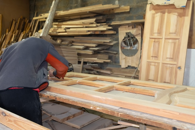 Restoration and repair of doors in workshop