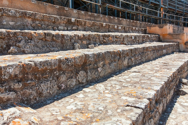 The restored ancient amphitheater with stone seats