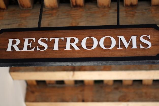 Restroom wc toilet wooden sign, street design