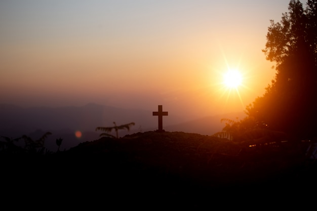 Resurrection concept: crucifixion of jesus christ cross at sunset