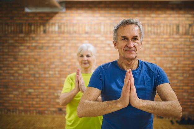 Retired couple in fitness center