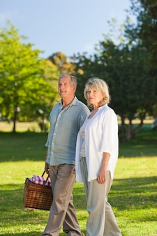 Retired couple looking for a place for picnicking